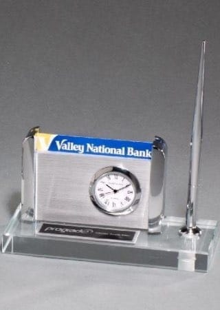 corporate gifts clock, pen, and business card holder